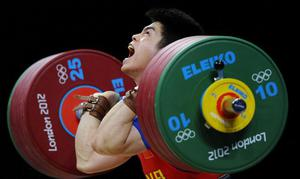 LONDON, ENGLAND - JULY 31:  Qingfeng Lin of China competes during the Men's 69kg Weightlifting Final on Day 4 of the London 2012 Olympic Games at ExCeL on July 31, 2012 in London, England.  (Photo by Laurence Griffiths/Getty Images)