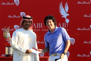 Rory McIlroy is presented with his third place cheque by Sheikh Sultan Bin Tahnoon Al Nahyan, Chairman of the Abu Dhabi Tourism Authority, after the final round of The Abu Dhabi Golf Championship