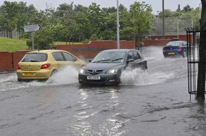 Cars Struggling threw the floods as rain as Heavy Rain hits across Northern Ireland