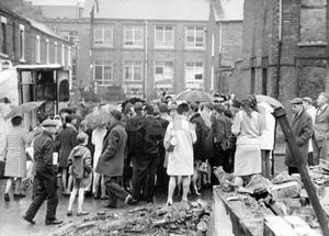 Riots : Belfast. August 1969.  The scene in the Clonard area of the Falls Road as M.P's from Westminster go on a tour of the devasted streets.  (24/8/69)