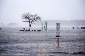 REHOBOTH BEACH, DE - OCTOBER 29:  Streets are under water as Hurricane Sandy approaches October 29, 2012 in Rehoboth Beach, Delaware. Hurricane Sandy is expected to make landfall between Atlantic City and Cape May around 6p.m.  (Photo by Alex Wong/Getty Images)