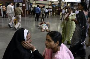 Passengers wait for their respective trains at Chhatrapati Shivaji railroad station, where the terror attacks began on Wednesday with shooters spraying gunfire,  in Mumbai, India, Saturday, Nov. 29, 2008. Indian commandos killed the last remaining gunmen holed up at a luxury Mumbai hotel Saturday, ending a 60-hour rampage through India's financial capital by suspected Islamic militants that killed people and rocked the nation. (AP Photo/Altaf Qadri)