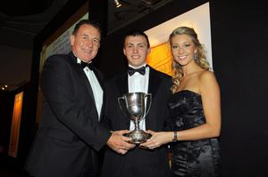 Carling Northern Ireland Football Writers Awards at the Europa Hotel in Belfast. Crusaders' Stuart Dallas receives the Carling Young Player of the Year award from Gerry Armstrong  and Carling girl Catherine Jennings