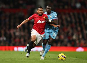 MANCHESTER, ENGLAND - NOVEMBER 28:  Anderson of Manchester United battles with Mohamed Diame of West Ham United during the Barclays Premier League match between Manchester United and West Ham United at Old Trafford on November 28, 2012 in Manchester, England.  (Photo by Clive Brunskill/Getty Images)