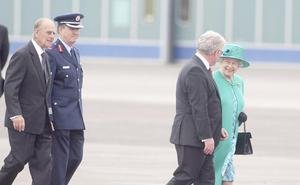 Britain's Queen Elizabeth II and the Duke of Edinburgh are greeted by Tanaiste Eamon Gilmore (front) upon arrival at Casement Aerodrome, Baldonnel, ahead of a four day state visit.