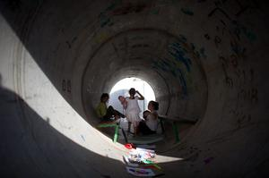 NITZAN, ISRAEL - NOVEMBER 19:  (ISRAEL OUT)  Israeli children play in a large concrete pipe used as a bomb shelter on November 19, 2012 in Nitzan, Israel. According to reports November 19, 2012, at least 90 Palestinians have been killed and more than 700 wounded during the Israeli offensive in the Gaza Strip.  (Photo by Uriel Sinai/Getty Images)