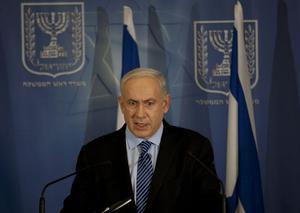 """Israel's Prime Minister Benjamin Netanyahu delivers a statement to the media at Hakirya a military base in Tel Aviv, Israel, Wednesday, Nov. 14, 2012. Israel's prime minister says the military is prepared to broaden its operation against Hamas targets in Gaza. Benjamin Netanyahu says Israel cannot tolerate continued rocket attacks against its citizens. In his first comments since Israel killed the commander of the Hamas military wing, Netanyahu said Wednesday that Israel is """"prepared to expand the operation"""". (AP Photo/Ariel Schalit)"""
