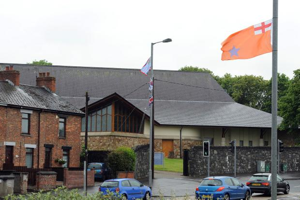 Paramilitary flags around the Woodburn Road area where St Nicholas Church and St Nicholas Primary School are located