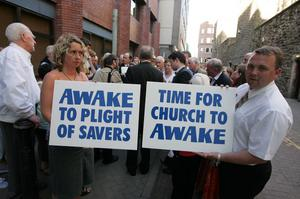 Presbyterian Mutual Society members hold protest outside Church House in Belfast at the start of the Presbyterian Church in Ireland's General Assembly