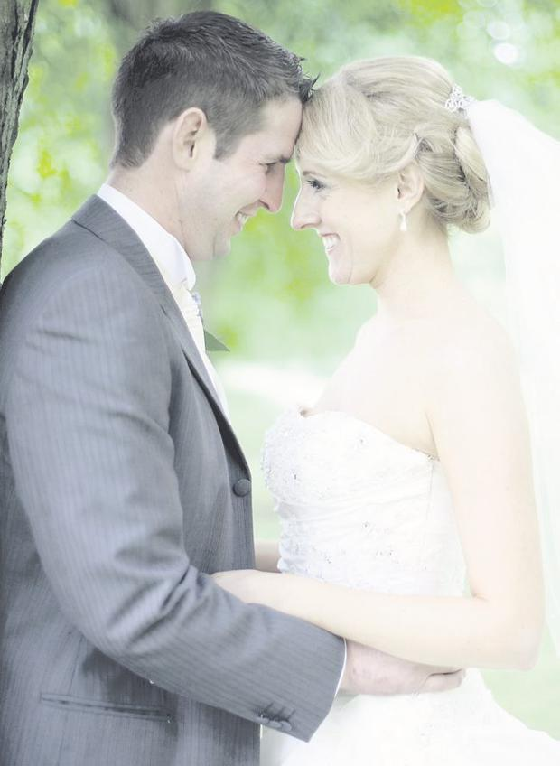 """Weather with you: Colm and Aine Fitzpatrick beat the hail storms to get their wedding pictures. <p><b>To send us your Wedding Pics <a  href=""""http://www.belfasttelegraph.co.uk/usersubmission/the-belfast-telegraph-wants-to-hear-from-you-13927437.html"""" title=""""Click here to send your pics to Belfast Telegraph"""">Click here</a> </a></p></b>"""