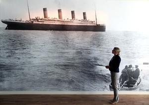 Ali Hill looks at a photograph of the Titanic.