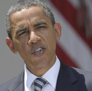 President Barack Obama has signed into law an emergency Bill to ensure the US does not default on its debt (AP)