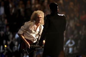 BELFAST, NORTHERN IRELAND - NOVEMBER 06:  Brian May of Queen performs with Adam Lambert during the MTV Europe Music Awards 2011 live show at the Odyssey Arena on November 6, 2011 in Belfast, Northern Ireland.  (Photo by Ian Gavan/Getty Images)