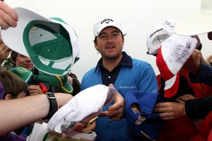 Graeme McDowell of Northern Ireland signs autographs during the second round of The JP McManus Invitational Pro-Am event at the Adare Manor Hotel and Golf Resort on July 6, 2010 in Limerick