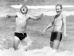 Northern Ireland striker Billy Hamilton of Burnley (right) and team physio Jimmy McGregor of Manchester United, enjoy a refreshing dip in the Mediterranean waters which lap their headquarters near Valencia. Cool Hamilton now aims to make a splash in the all-important Group Five game against Honduras in Zaragoza on Monday night.