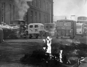 Riots : Belfast. August 1969.  Smoke still billows out of a factory on the Falls Road, which was severely damaged by fire when trouble broke out in Belfast last night.  14/8/69.