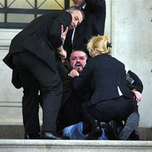 The two security guards restrain Michael Stone outside Stormont