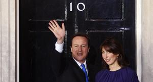 Britain's new Prime Minister David Cameron and his wife, Samantha, wave on the doorstep of 10 Downing Street after an audience with The Queen