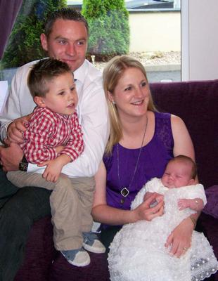 Baby Grace and her brother, mum and dad..