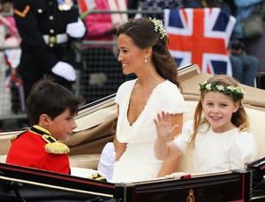 LONDON, ENGLAND - APRIL 29:  Sister of the Bride and Maid of Honour Pippa Middleton and bridesmaid Margarita Armstrong-Jones ride in a carriage procession to Buckingham Palace following the marriage of Their Royal Highnesses Prince William, Duke of Cambridge and Catherine, Duchess of Cambridge at Westminster Abbey on April 29, 2011 in London, England. The marriage of the second in line to the British throne was led by the Archbishop of Canterbury and was attended by 1900 guests, including foreign Royal family members and heads of state. Thousands of well-wishers from around the world have also flocked to London to witness the spectacle and pageantry of the Royal Wedding.  (Photo by Sean Gallup/Getty Images)