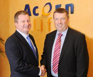 Kainos director Noel Crowley (l) joined Gerard Ryan, operations director at Acorn Life, to mark the new £2m deal