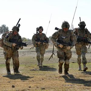 Soldiers cross open ground during Operation Zamary Kargha in Helmand