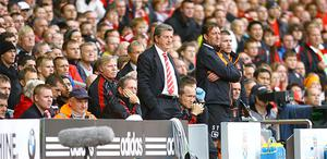 Liverpool manager Roy Hodgson and his backroom staff - and many disgruntled fans - watch in disbelief as Blackpool sweep to victory at Anfield. The result left them languishing in the bottom three