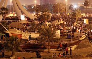 Bahraini anti-government protesters prepare for a second night camping out at the Pearl roundabout in Manama, before the assault by riot police.