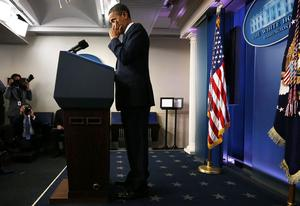 WASHINGTON, DC - DECEMBER 14:  U.S. President Barack Obama wipes tears as he makes a statement in response to the elementary school shooting in Connecticut December 14, 2012 at the White House in Washington, DC. There are 27 dead, 20 of them children, after Adam Lanza reportedly opened fire in one of the largest school massacres in U.S. history. Lanza is dead at the scene and his mother, a teacher at the school, is also dead.   (Photo by Alex Wong/Getty Images)