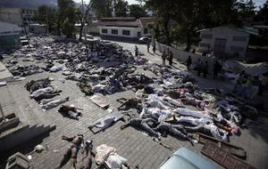 Bodies fill the frontyard of the morgue in Port-au-Prince