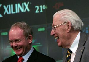 Martin McGuiness, left, Northern Ireland's Deputy First Minister, and Ian Paisley, right, First Minister, react after ringinging the opening bell at the Nasdaq stock exchange in New York, Wednesday Dec. 5, 2007