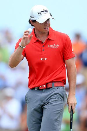 KIAWAH ISLAND, SC - AUGUST 12: Rory McIlroy of Northern Ireland waves after a birdie putt on the seventh green during the Final Round of the 94th PGA Championship at the Ocean Course on August 12, 2012 in Kiawah Island, South Carolina.  (Photo by David Cannon/Getty Images)
