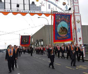 Ballydougan LOL 120 pass under the Queen Street arch during the Twelfth parade through Lurgan. Picture By Rick Hewitt. 12/7/11.