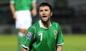 Damien Johnson during his playing days with Northern Ireland