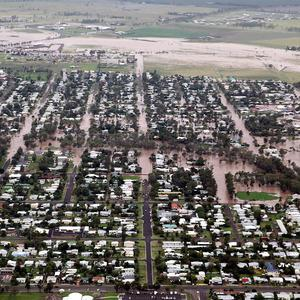 Military aircraft dropped supplies to towns cut off by floods in north-east Australia (AP)