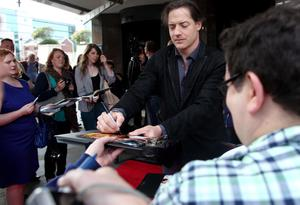 10.06.12. PICTURE BY DAVID FITZGERALDThe opening of the Belfast Film Festival at the Waterfront Hall, Belfast last night. Brendan Fraser signing autographs for fans