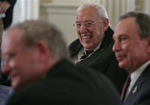 Martin McGuiness, left, Northern Ireland's Deputy First Minister, Ian Paisley, Northern Ireland's First Minister, center, and Mayor Michael Bloomberg, right, react as they listen during a meeting at City Hall in New York, Monday, Dec. 3, 2007. Paisley and McGuinness are on their first US trip together to drum up business for Northern Ireland's economy.