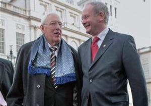Ian Paisley and Martin McGuiness, right chat as they leave after a meeting at City Hall in New York, Monday Dec. 3, 2007
