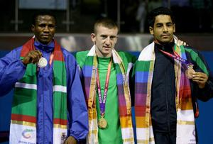 (L-R) Medalists Jafet Uutoni of Namibia (silver), Paddy Barnes of Northern Ireland (gold) and Amandeep Singh of India (Bronze) pose during the medal ceremony for the Light Fly Weight (46-49kg) Men Finals Gold Medal Bout at Talkatora Indoor Stadium on day ten of the Delhi 2010 Commonwealth Games on October 13, 2010 in Delhi, India