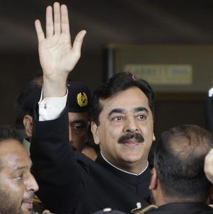 Yousuf Raza Gilani waves upon his arrival at the Supreme Court for a hearing in Islamabad (AP)