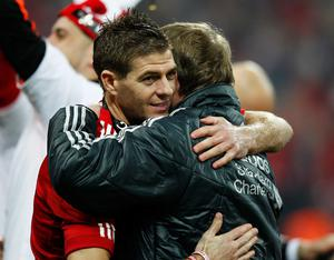 LONDON, ENGLAND - FEBRUARY 26:  Kenny Dalglish manager of Liverpool celebrates victory with Steven Gerrard after the Carling Cup Final match between Liverpool and Cardiff City at Wembley Stadium on February 26, 2012 in London, England. Liverpool won 3-2 on penalties.  (Photo by Paul Gilham/Getty Images)