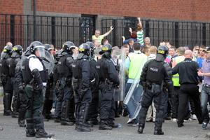 Press Eye - Belfast - Northern Ireland -   Sunday 2nd August  2012- Picture by Kelvin Boyes / Press Eye.Disturbance between Loyalists and Republicans at the Carlisle Circus area of north Belfast following a parade in the area.Police move back republicans at Carlisle Circus
