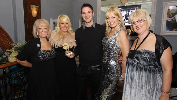 Male Model of the Year Rob Rea with Valerie Kirkpatrick, Joleen McKee, Alison Campbell and  Louise Roe at the Alison Campbell Modelling Agency Christmas Party at Cafe Vaudeville. Picture by Kelvin Boyes / PressEye.com