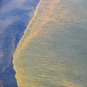Oil seen from an aerial view at the Deepwater Horizon oil spill site in the Gulf of Mexico (AP/US Navy)