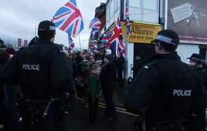 Loyalist hold protest at Naomi Long's east Belfast Alliance office following a council vote last night which will see the Union Flag only follow certain days.