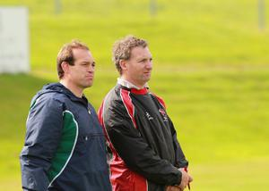 Simon Best (left) watches Banbridge from the sidelines, and in his playing hey-day