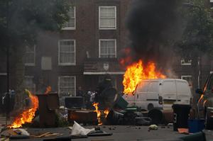 LONDON, ENGLAND - AUGUST 08:  Rioters set fire to barricades they constructed in Goulton Road in Hackney on August 8, 2011 in London, England. Pockets of rioting and looting continues to take place in various boroughs of London this evening, as well as in Birmingham, prompted by the initial rioting in Tottenham and then in Brixton on Sunday night. It has been announced that the Prime Minister David Cameron and his family are due to return home from their summer holiday in Tuscany, Italy to respond to the rioting. Disturbances broke out late on Saturday night in Tottenham and the surrounding area after the killing of Mark Duggan, 29 and a father-of-four, by armed police in an attempted arrest on August 4.  (Photo by Dan Istitene/Getty Images)