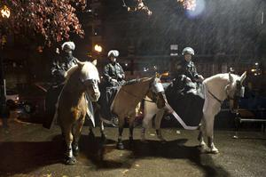 PORTLAND, OR - NOVEMBER 13: Police on horseback prepare to act on Occupy Portland camp November 13, 2011 in Portland, Oregon.  In spite of an eviction notice for early Sunday morning, Portland police delayed closing two downtown parks early today as thousands of people converged to support the Occupy Portland movement.(Photo by Natalie Behring/Getty Images)