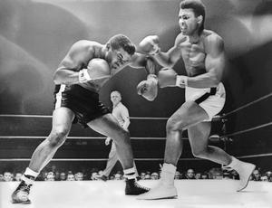 1965: Cassius Clay (Muhammad Ali) spars with challenger Floyd Patterson during the World Heavyweight Championship fight. Clay won the fight with a technical knockout in the 12th round November 25, 1965 in Las Vegas, Nevada.