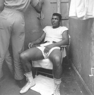 1964: American boxer Cassius Clay (now Muhammad Ali) rests during training for the world heavyweight title fight against fellow American Sonny Liston at Miami Beach, Florida. Ali went on to win the match, making him world heavyweight champion for the first time.